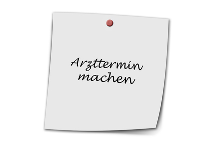 doctor's appointment: Arzttermin machen (german make doctors appointment) written on a memo isolated on white background