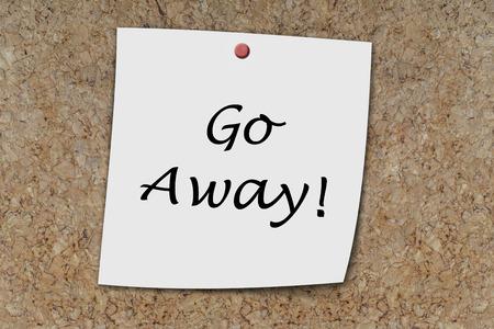 piss: Go Away written on a memo pinned on  a cork board