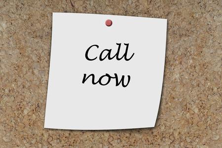 memo board: Call Now written on a memo pinned on cork board Stock Photo
