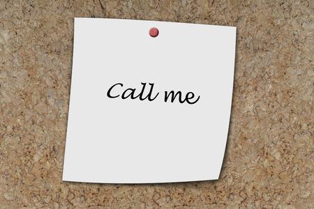 memo board: Call me written on a memo pinned on cork board