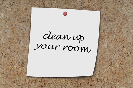 clean up: clean up your room written on a memo pinned on a coak board
