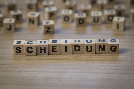 couple fight: Scheidung (german Divorce) written in wooden cubes on a table