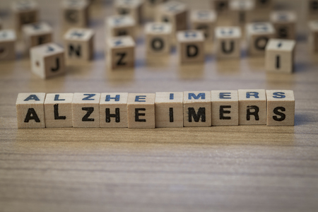 alzheimers: Alzheimers written in wooden cubes on a table