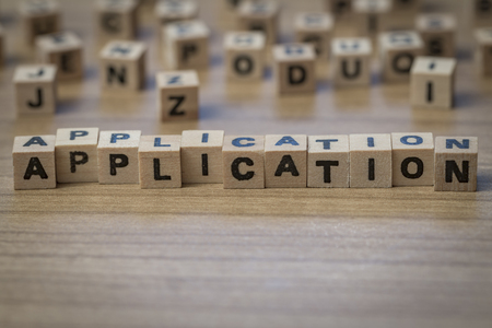 employe: Application written in wooden cubes on a table Stock Photo