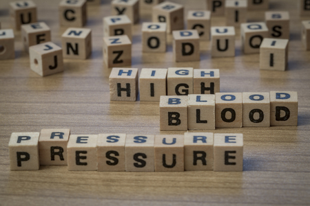 high blood pressure: High blood pressure written in wooden cubes on a table