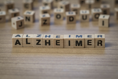 alzheimer's: Alzheimer (German Alzheimers) written in wooden cubes on a table
