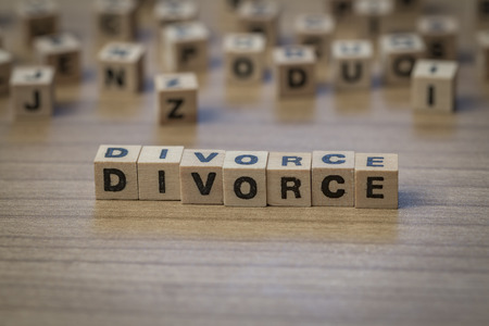 couple fight: Divorce written in wooden cubes on a table