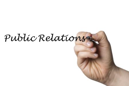 relaciones publicas: Relaciones p�blicas escritas por una mano aisladas sobre fondo blanco Foto de archivo