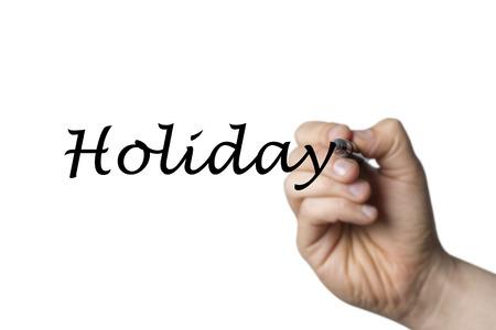 comunicación escrita: Holiday escrita por una mano aislada sobre fondo blanco Foto de archivo