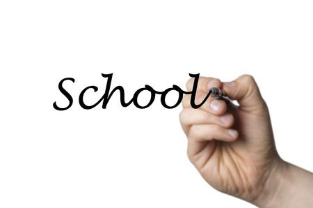comunicación escrita: Escuela escrita por una mano aislada sobre fondo blanco
