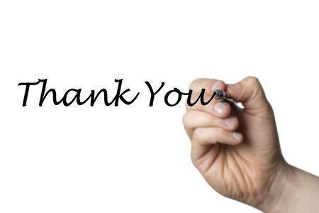 comunicación escrita: Thank you written by a hand isolated on white background Foto de archivo