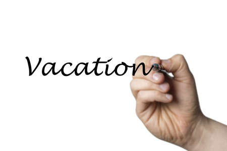 comunicaci�n escrita: Vacation written by a hand isolated on white background
