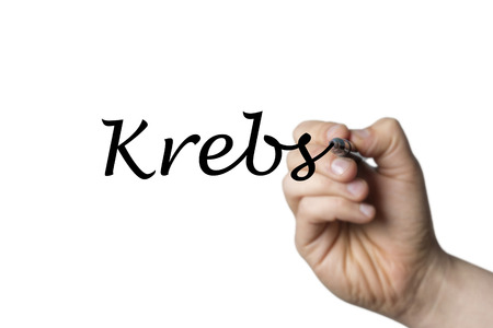 Krebs (German Cancer) written by a hand isolated on white background