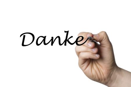 comunicaci�n escrita: Danke escrita por una mano aislada en el fondo blanco
