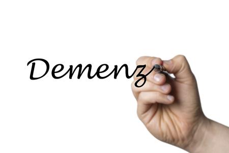 comunicación escrita: Demenz escrita por una mano aislada en el fondo blanco