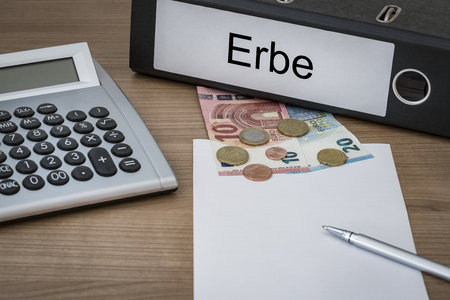 successor: Erbe (german heritage) written on a binder on a desk with euro money calculator blank sheet and pen Stock Photo