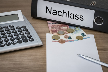 dolor: Nachlass (German inheritance) written on a binder on a desk with euro money calculator blank sheet and pen