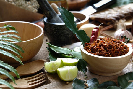 Assortment of Thai food Cooking ingredients. Spices ingredients chilli pepper garlicgalanga and kaffir lime leaves. Stock Photo