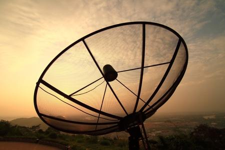 Satellite dishes atop a mountain photo