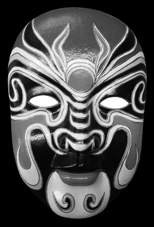 black and white mask isolated on black background photo