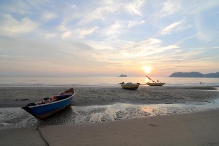 Fishing boats along the coast Stock Photo
