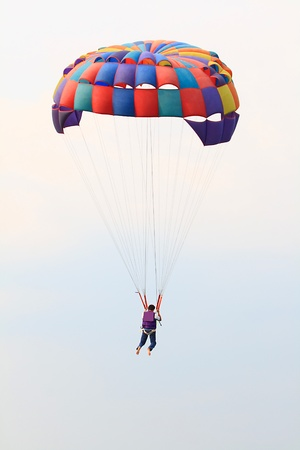 Colorful parachute against clear sky