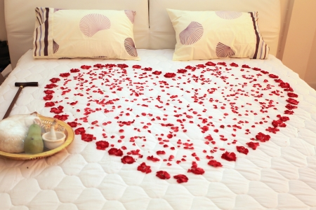 romantic: Heart on a bed of roses