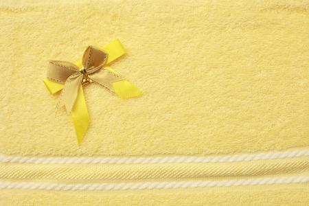 towel yellow bind ribbon gold pattern white Stock Photo - 14629913
