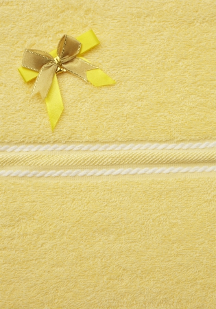 towel yellow bind ribbon gold pattern white   Stock Photo