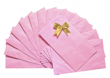 pink envelope with golden bowl isolated background white photo