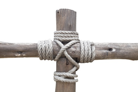 Rope tied to a wooden cross isolated on white background