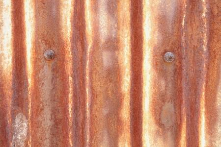 Old rusty galvanized sheet patterned background photo