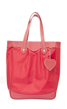 red leather bag have heart isolated on white background