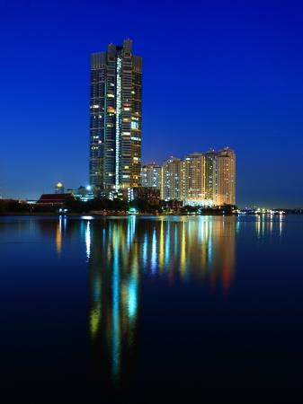 Condo along the Chao Phraya water reflections evening