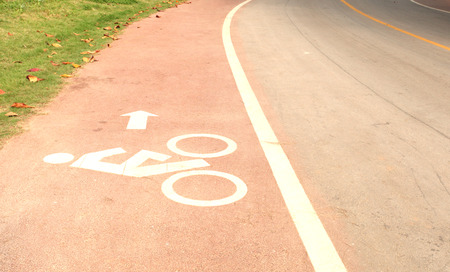 symbol bicycle path out city on the road asphalt