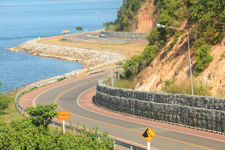 beach road winding during the summer bright sky Stock Photo