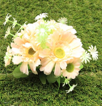 plastic flowers color bright closeup background grass