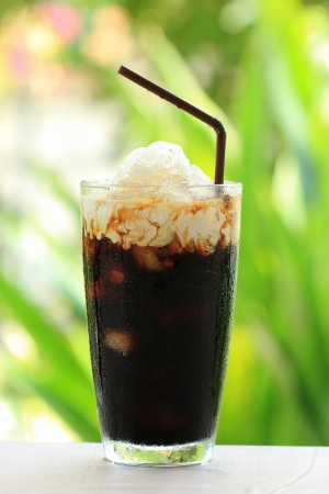 Thai Ice Black coffee topping with fresh milk  photo