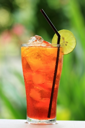 Thai Ice Tea Lemon Iced drink with slices of lime and ice   photo