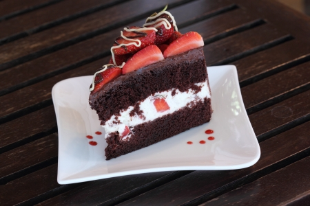 tantalizing: Strawberry Chocolate lover Cake  A chocolate cake with strawberries with slice on the white plate