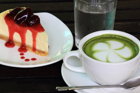 Strawberry cheese cake and Green tea Latte with ie water photo