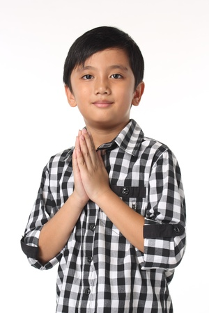 thai boy: Sawasdee , A Smilling Thai boy paying respect