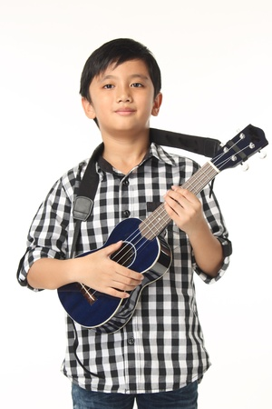 fop: Boy Child With Guitar Music Playing on White Background Stock Photo