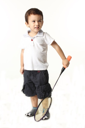 Cute boy playing batminton on white background photo