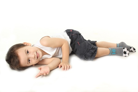 tailor seat: A little boy lie down on the floor