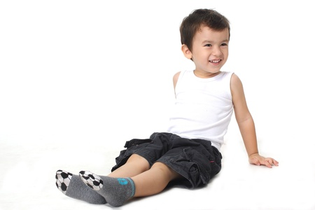 A little boy smiling sit on the floor   photo
