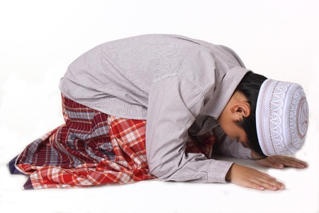 Islamic pray explanation  Asian child showing complete Muslim movements while praying  Stock Photo