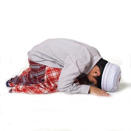 islamic pray: Islamic pray explanation  Asian child showing complete Muslim movements while praying  Stock Photo