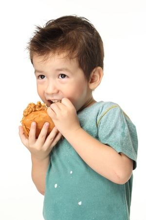 The little boy eating a hamburger The boy eating a hamburger  Selective focus on a hamburger  Isolated on a white background   Stock Photo