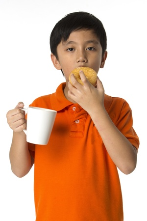 dough nut: Kit eating dough nut with hot drink